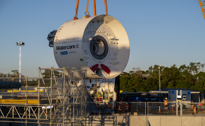 Image of a piece of the Central Interceptor tunnel boring machine being lowered into the main shaft