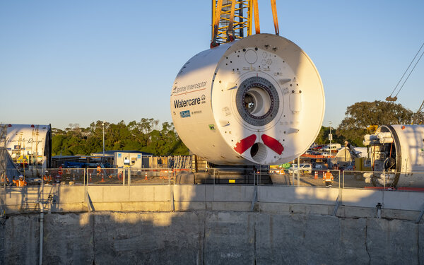 Giant Tunnel Boring Machine (TBM) lowers into shaft for groundbreaking Central Interceptor project